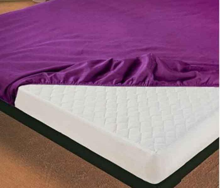 Aprenda a dobrar um lençol com elástico